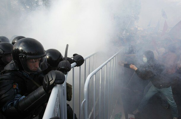 Riot police try to remove barricades from participants of a