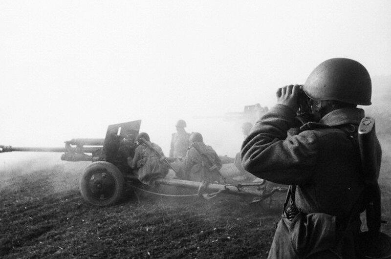 Soviet Soldier Observes Battle Through Binoculars