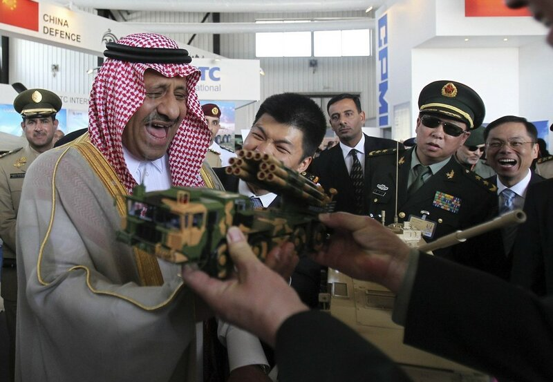 Saudi Deputy Defence Minister Prince Khaled Bin Sultan laughs during his visit to the Chinese section, at the opening of the Special Operations Forces Exhibition and Conference (SOFEX) at King Abdullah I Airbase in Amman