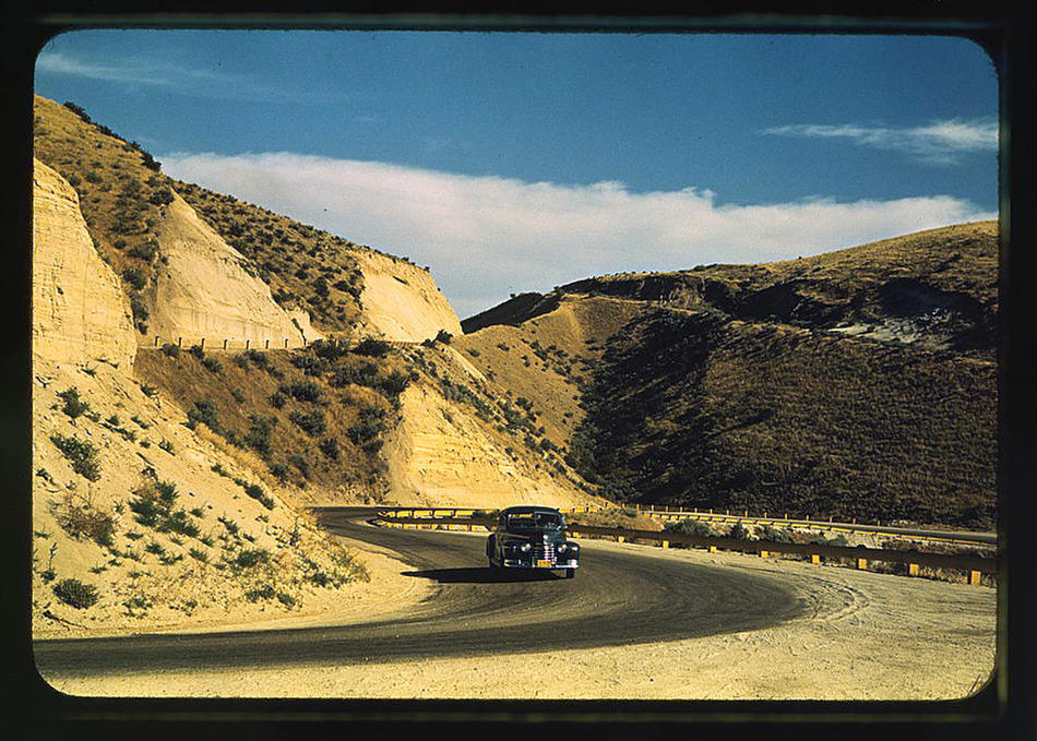 Road cut into the barren hills which lead into Emmett. Emmett, Idaho, July 1941. Reproduction from color slide. Photo by Russell Lee. Prints and Photographs Division, Library of Congress