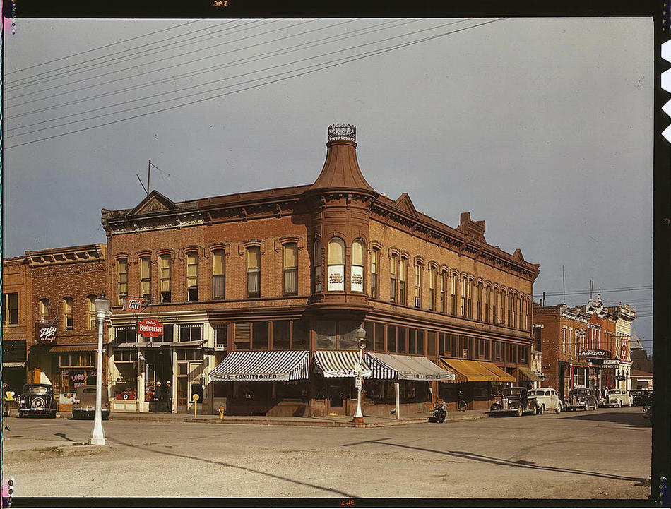 Street corner. Dillon, Montana, August 1942. Reproduction from color slide. Photo by Russell Lee. Prints and Photographs Division, Library of Congress