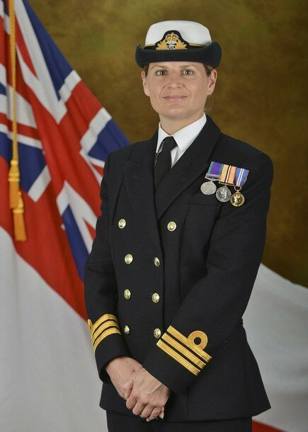 The first woman in the Royal Navy s history to command a major warship, Commander Sarah West, poses for the photographer in this photograph received in London