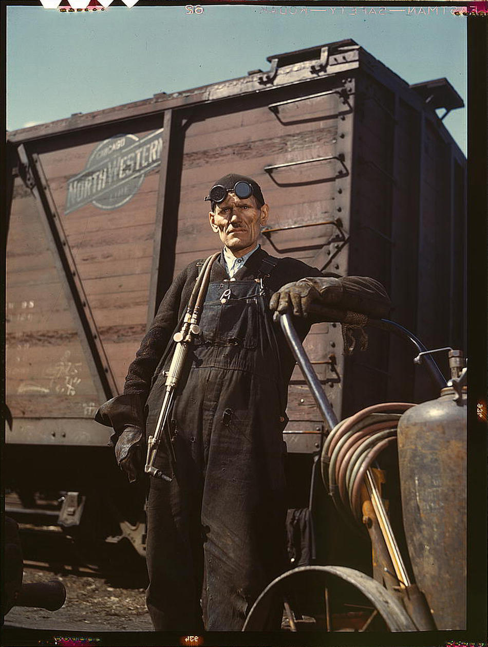 Mike Evans, a welder, at the rip tracks at Proviso yard of the Chicago and Northwest Railway Company. Chicago, Illinois, April 1943. Reproduction from color slide. Photo by Jack Delano. Prints and Photographs Division, Library of Congress