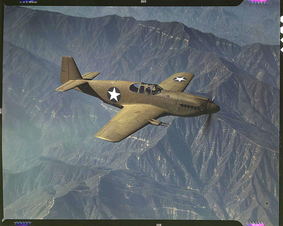 P-51 'Mustang' fighter in flight. Inglewood, California, October 1942. Reproduction from color slide. Photo by Alfred T. Palmer. Prints and Photographs Division, Library of Congress