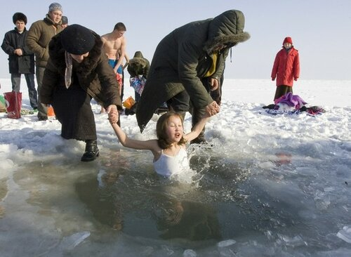 Girl bathes in icy water during Orthodox Epiphany celebrations north of Almaty
