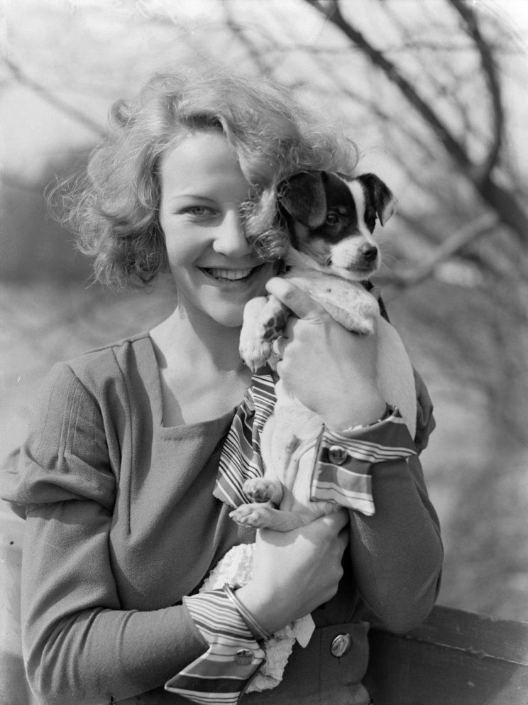 Woman holding a puppy