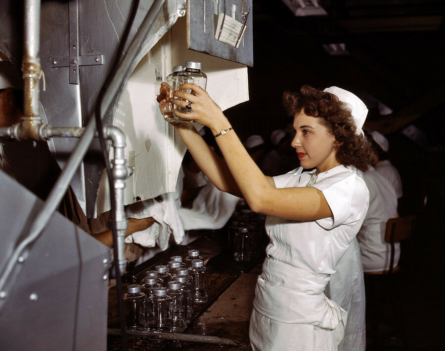 "October 1942. Glenview, Illinois. ""Transfusion bottles containing intravenous solution are given final inspection by Grace Kruger, one of many women employees at Baxter Laboratories.jpg"