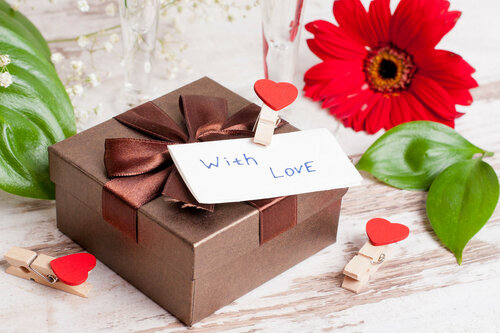 gift box, a note and hearts for Valentine's Day