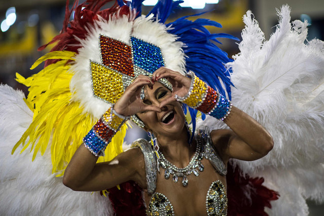Revellers of Vila Isabel samba school perform during the second night of the carnival parade at the