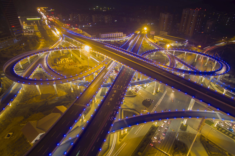 A highway overpass lighted in blue is seen during a hazy night in Jinan, Shandong province, on Decem
