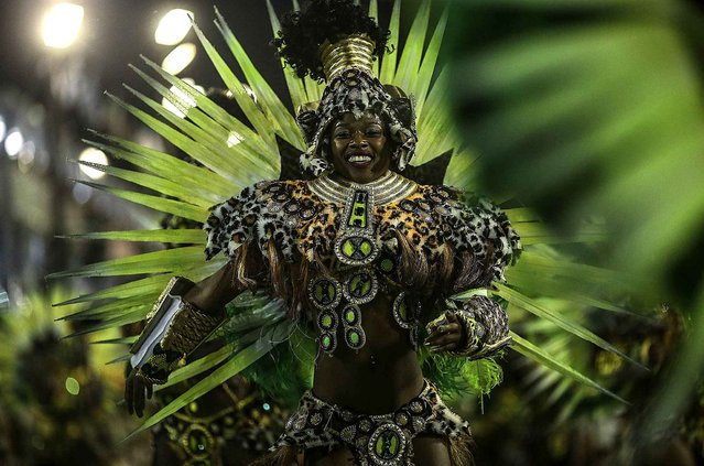 A member of Samba school Mocidade takes part in a parade, based on Don Quixote, as part of first day