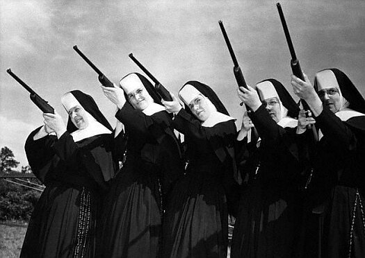 Row of Nuns Aiming Rifles