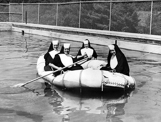 Nuns Rafting on Water