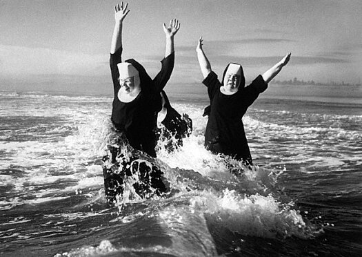 Nuns Playing in Water