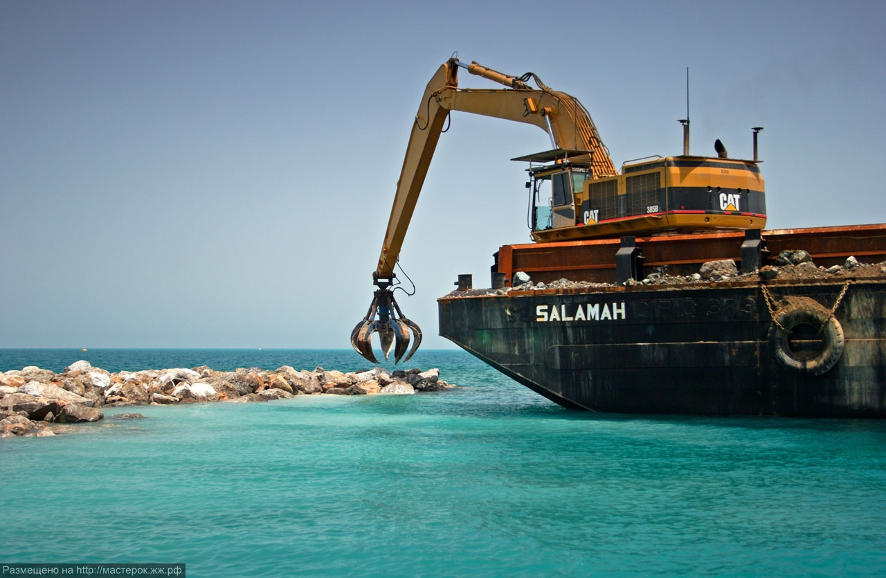 The World Island project being built 4km's off the coast of Dubai. A barge crane places rocks on the sea bed to construct a breakwater that will shield the The World Islands from rough sea's and high tides.