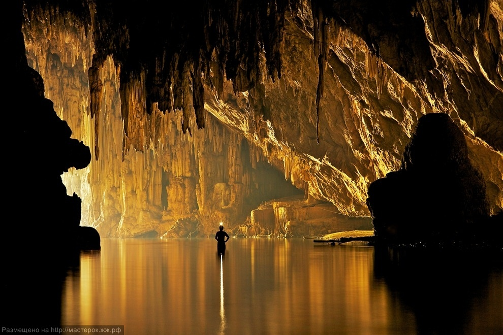 ***EXCLUSIVE***<br />PANG MAPHA, THAILAND - UNDATED: John Spies explores the Tham Lod cave in Pang Mapha, Thailand.<br />A SUBTERREAN photographer has captured jaw-dropping pictures of cavers exploring mighty cave cathedrals. The formations are so large cavers ha