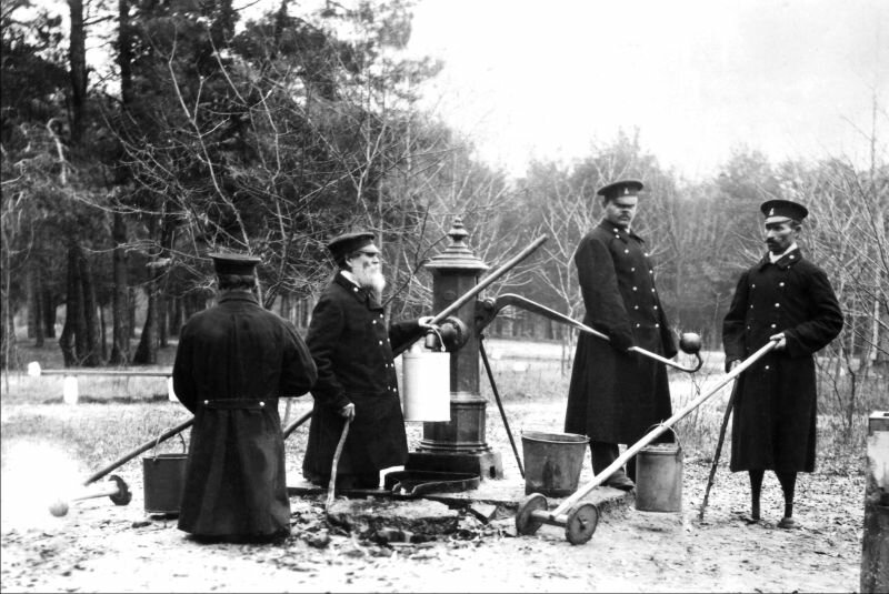 Invalids at the well. Taken at the western branch of the Emperor Alexander II invalid's home for railway employees, Grodno province, Brest District, 1901.