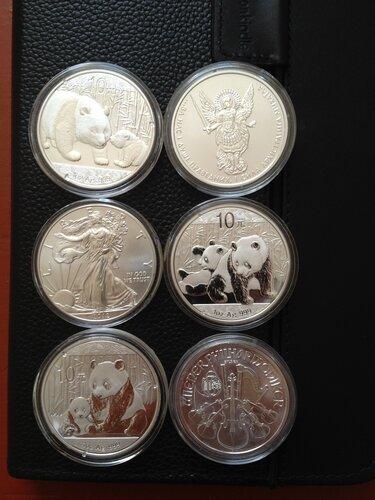Красивые серебряные монетки Китая, США, Австрии и Украины (инвестиционные)
