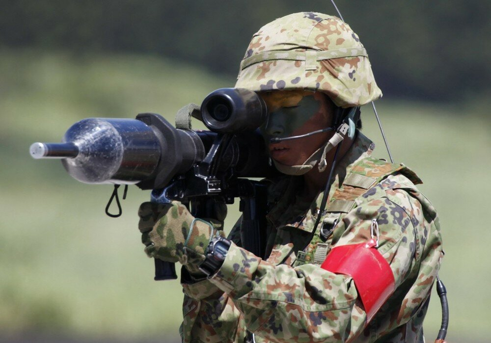 A Japanese Ground Self-Defense Force soldier holds an anti-tank weapon during an annual training session near Mount Fuji at Higashifuji training field in Gotemba