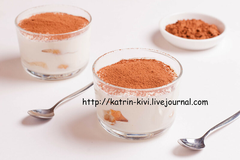Tiramisu in glass on white table, traditional coffee flavored Italian dessert made of ladyfingers and mascarpone