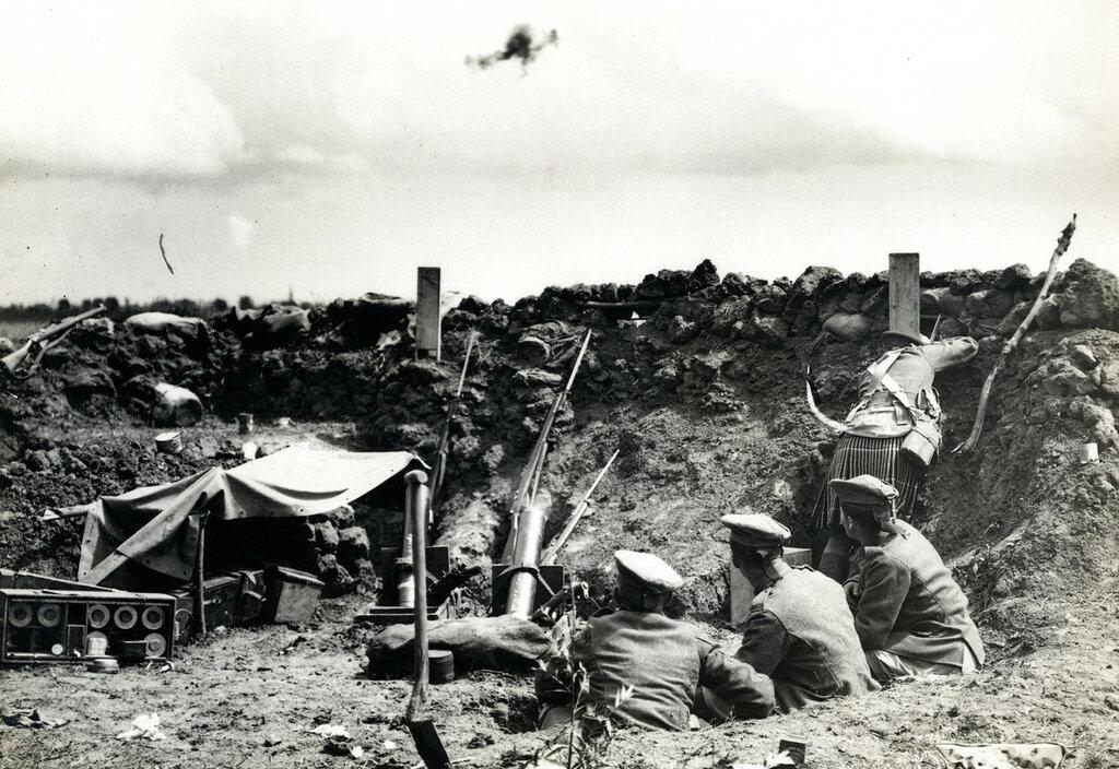 Bomb Gun Section firing a bomb [St Floris, France].23 Jul 1915