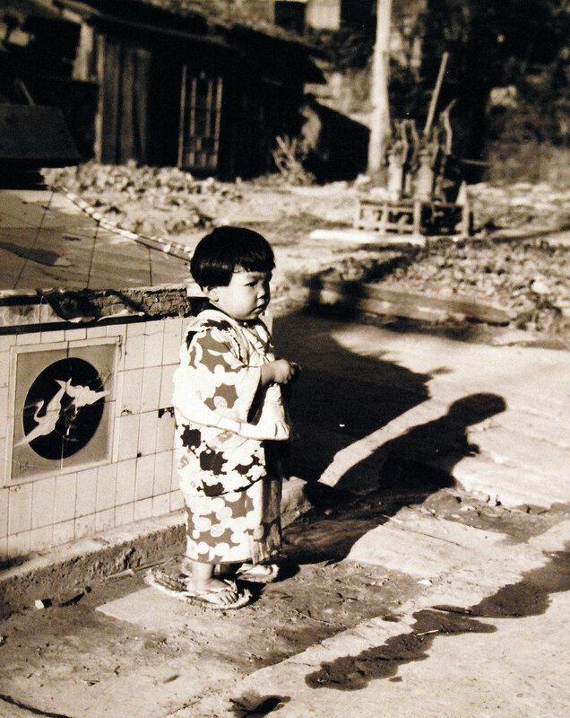 Scene at Sasebo, Kyushu, shows Japanese child. October 19, 1945