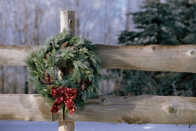 Frosted Pine Wreath on Wooden Fence Winter Alaska --- Image by © Alaska Stock/Corbis