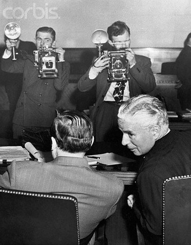Cameramen Photographing Charlie Chaplin and His Attorney