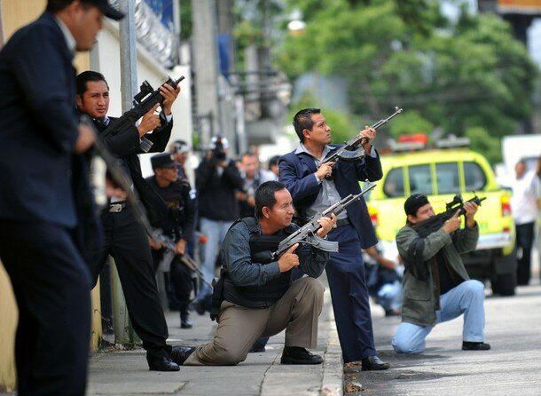Guatemalan National Police agents aim th