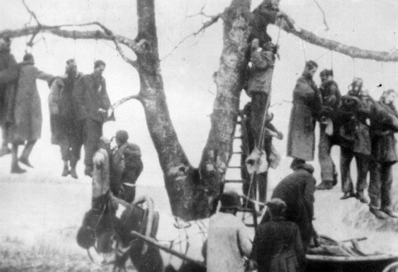 Soviet POWs hanged on a tree in Kharkov by German soldiers.jpg
