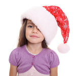 Portrait of happy little girl in Santa hat