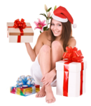 Christmas girl in santa hat, flower, gift box in spa.