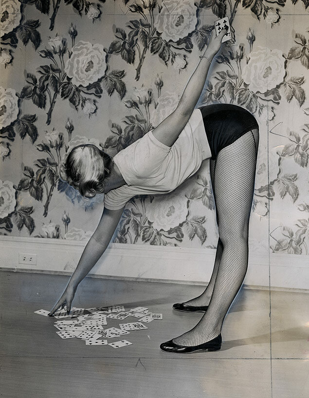 Miss Filter King, the dancer under the Old Gold dancing cigarette pack, demonstrates how she keeps her lovely legs in great shape with a pickup 52 stretching routine