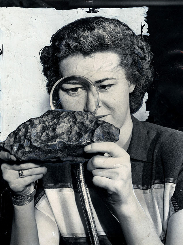 Edythe Byers examines a meteorite, the much smaller version of a runaway comet that could destroy the earth