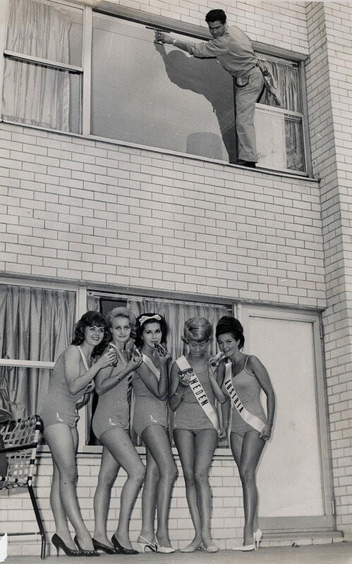 A window cleaner at the Squires Hotel has a bird's-eye view of hot dog-munching contestants in the International Beauty Pageant
