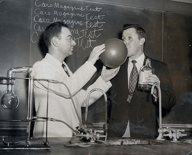 Alcoholic Testing. Dr. Kurt M. Duboski, from Norwalk Hospital, obtains a sample of breath from Harry Stevenson, a student volunteer who has just consumed 9 oz. of 100 proof whiskey. 1953-06-04