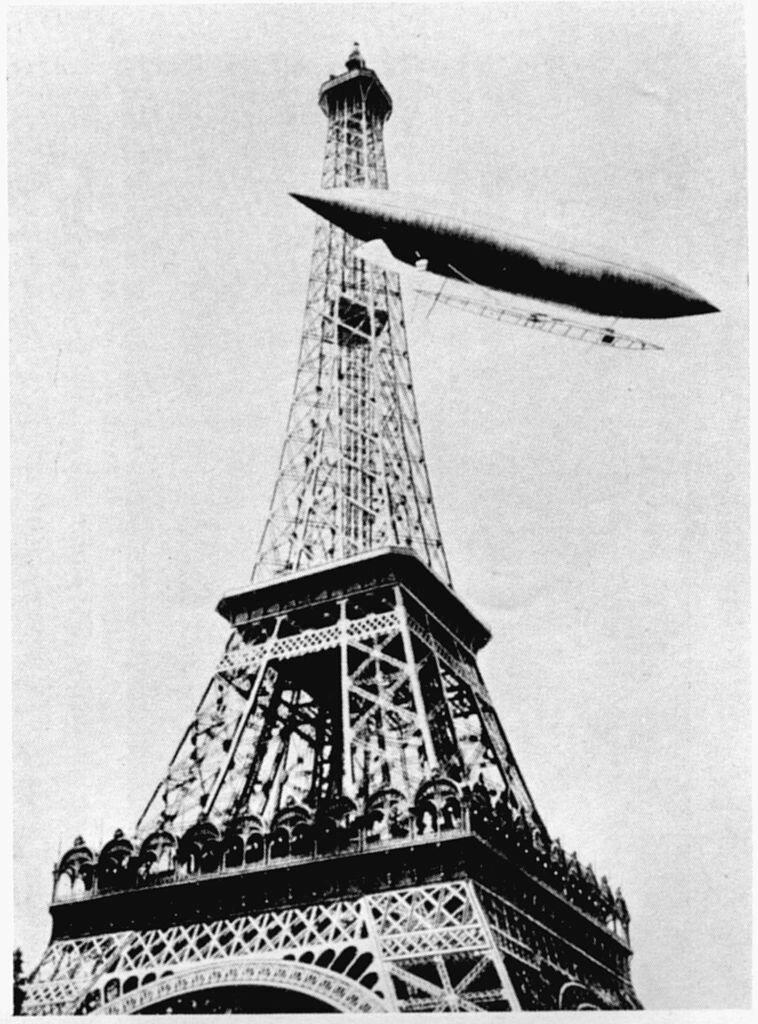 огибает Эйфелеву башню,