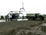 Аэропорт Ванавары. Дождь. Погрузка в МИ-8. Airport of Vanavara. Rain. Loading is in helicopter Mi-8.