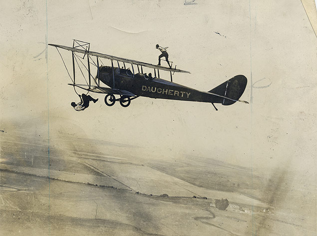 Aerial daredevils Wesley May and Clarence Dragunier perform their stunts two miles above the New York countryside. 1929-01-08