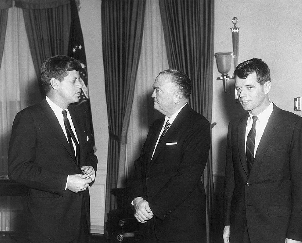 23 February 1961  Meeting with the Attorney General and Director of the Federal Bureau of Investigation. President Kennedy, Director Hoover, Attorney General Kennedy. White House, Oval Office. Photograph by Abbie Rowe