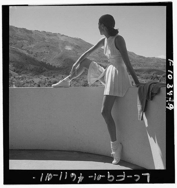 Woman wearing tennis outfit. (1947).
