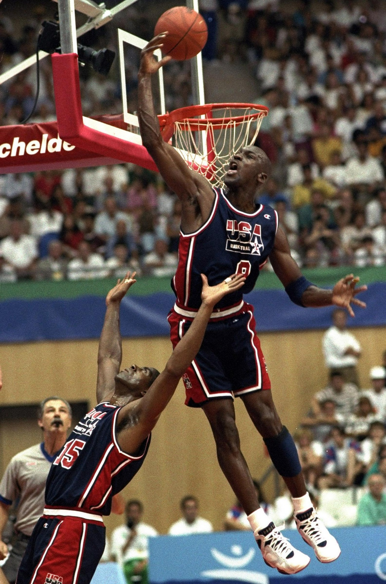FILE - In this July 27, 1992 file photo, USA's Michael Jordan sails high above teammate Magic Johnson knocking away a shot during the first half of their preliminary round basketball game with Croatia at the Summer Olympics in Barcelona. With USA Basketba
