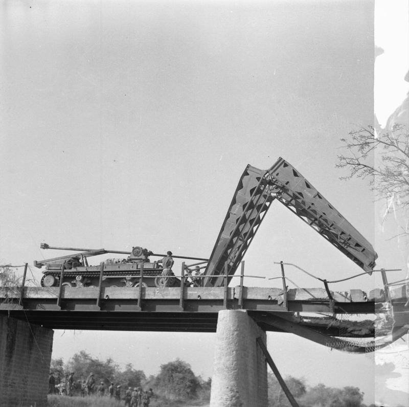 A Valentine bridgelayer of the 3rd Independent Bridge Building Company, Royal Armoured Corps, spans a damaged bridge near Meiktila, 28 March 1945.