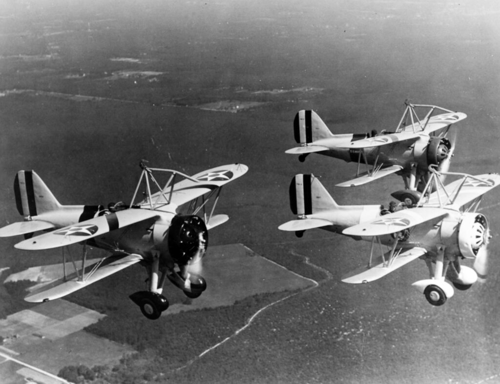 Curtiss F9C-2 Sparrowhawk fighters Flying in a V formation, circa 1933-1935. These planes are part of the heavier-than-air group of USS Macon (ZRS-5).