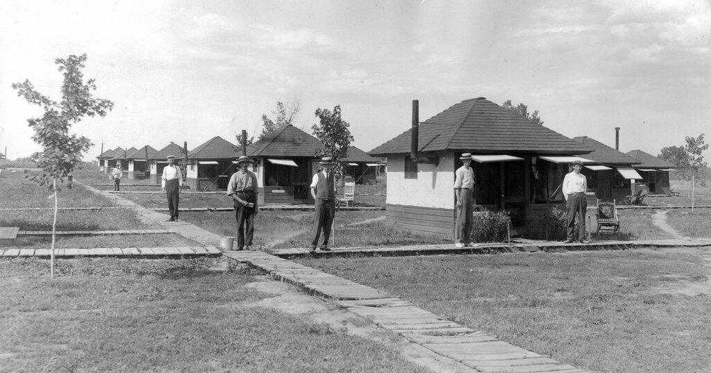 Men stand on boardwalks at Craig Colony (Craig Hospital) a tuberculosis sanitarium in Edgewater (Jefferson County), Colorado. between 1920