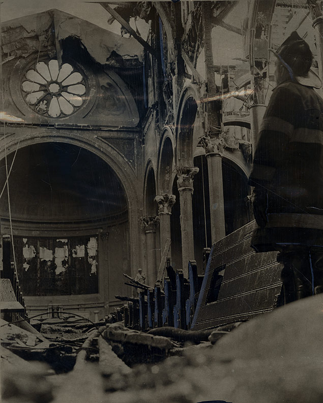Fireman J. De Bellonia surveys the ruins of the fire-gutted Epiphany Roman Catholic Church on 2nd Avenue