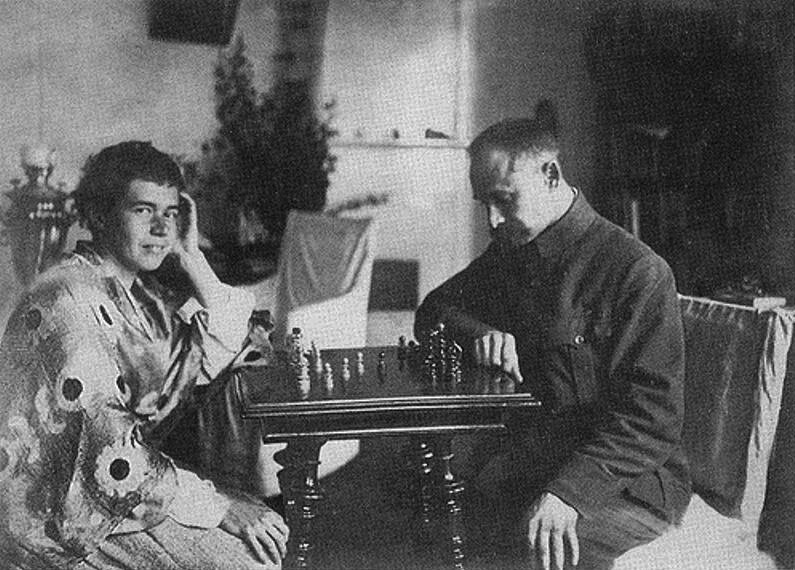 Doctor I. A. Tikhomirov playing chess with a wounded patient at the Winter Palace, Petrograd, 1915-17.