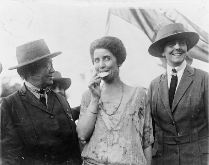 President Calvin Coolidge's wife is shown eating a Girl Scout cookie, 1923