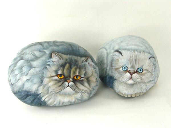 изображение котов на камне