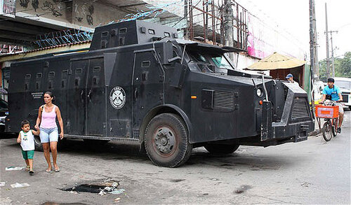 An armoured police vehicle patrols the Jacarezinho slum in Rio de Janeiro...An armoured police vehicle patrols the Jacarezinho slum in Rio de Janeiro November 24, 2010. Authorities in Rio de Janeiro struggled to control a fourth day of violence apparently